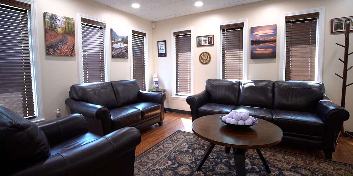 dental lobby with dark brown leather couches